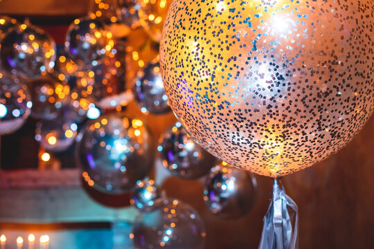 Decoration interior elements of restaurant venue banquet hall with multicoloured different helium balloons, on a indoor corporate event or wedding reception or birthday party celebration