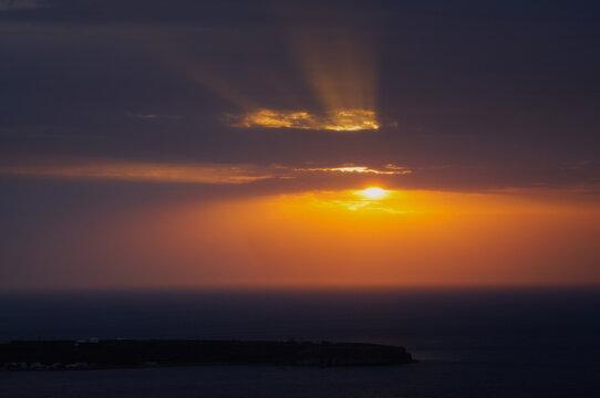 Winter Sunset at Thirasia, view from Oia village Santorini
