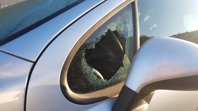 The burglar broke the side window of the car to steal. An example for insurance against robbery.