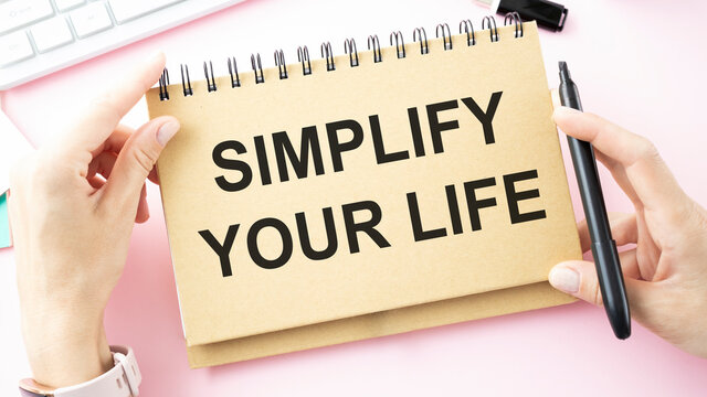 Simplify your life word written in notebook.Conceptual hand writing showing Simplify Your Life.