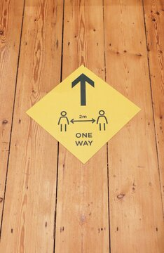 Sign indicating covid safe social distancing and one way
