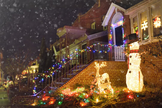 A street decorated for Christmas and New Year holidays in the Dyker Heights neighborhood, New York, USA.