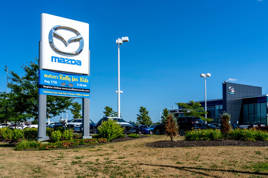 Barrie, Ontario, Canada - August 4, 2019: Mazda pole sign outside a dealership in Barrie,  Ontario, Canada.  Mazda Motor Corporation is a Japanese multinational automaker.