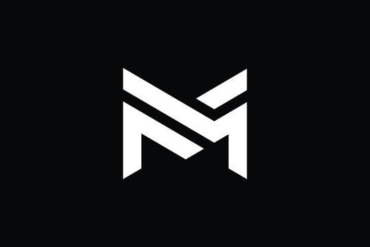 M logo letter design on luxury background. MM logo monogram initials letter concept. M icon logo design. MM elegant and Professional letter icon design on black background. M MM