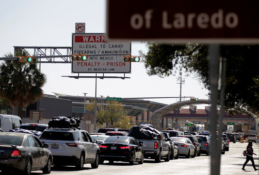 Mexican migrants and Americans of Mexican origin queue to cross the U.S.-Mexico border to celebrate Christmas and New Year's Eve with their loved ones in Mexico, in Laredo