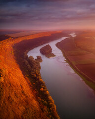 Wall Mural - Beautiful top view of winding river in sunset. Scenic image of drone photography.