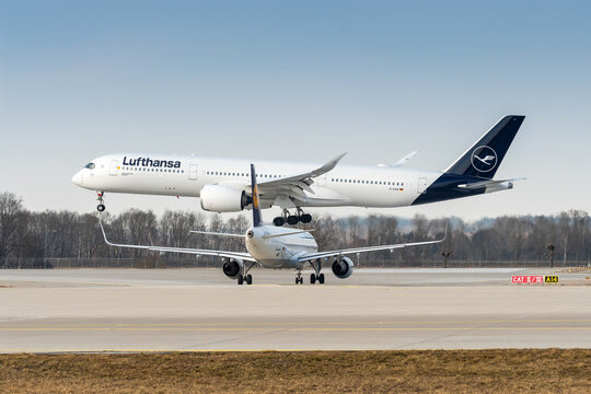 Lufthansa Airbus A350-941 with the aircraft registration D-AIXK in the approach to the northern runway 26R of the Munich Airport MUC EDDM