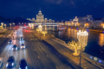 Moscow. Russia. New Year's Moscow from the Quadcopter. Highway along the Moscow River. Cars drive on a night road. Christmas capital. New Year in the cities of Russia. Christmas illumination Fotobehang