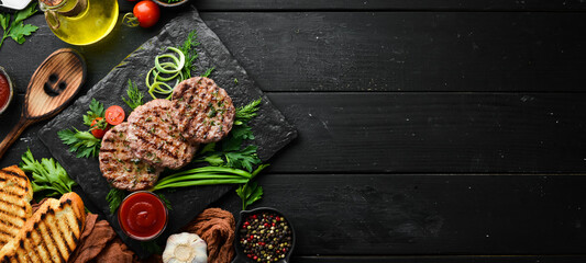 Grilled meat cutlets. Cutlets for burger. Top view. Free space for your text.
