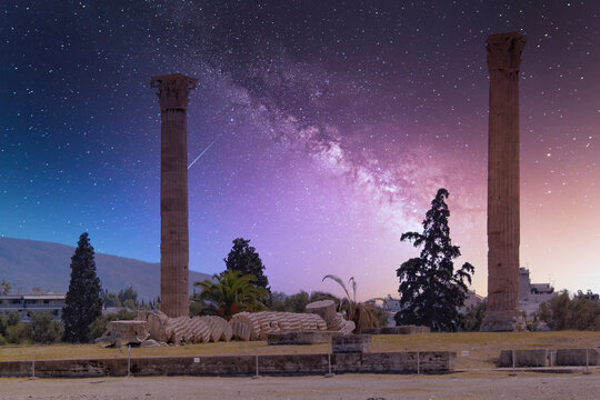 two columns of the Olympian Zeus ancient temple illuminated by starry night sky, Athens Greece