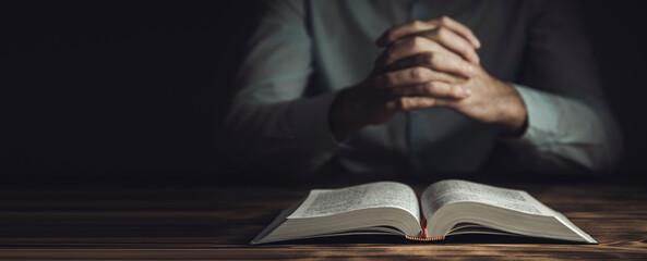 Fototapeta prayer hands on a Holy Bible obraz