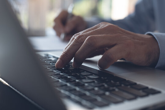 online learning, E-learning, studying online, E-education concept. Close up of man hand typing, working on laptop in office