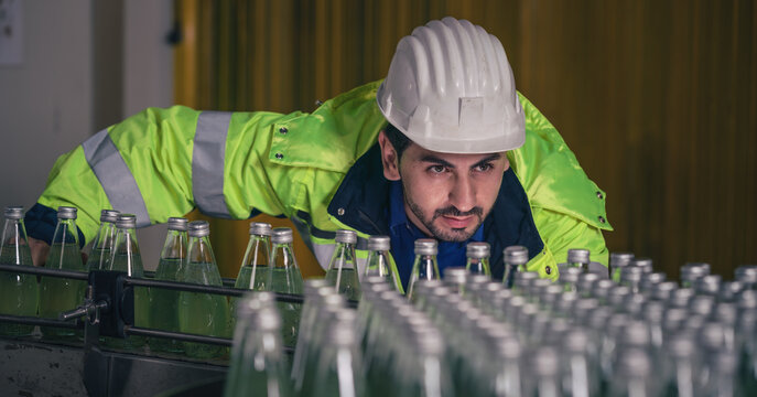 beverage factory production line engineer checking production line