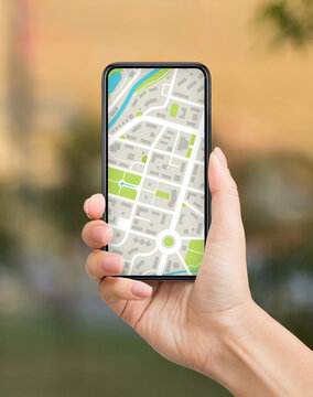 City Navigation. Smartphone With Mobile Map On Screen In Female Hand