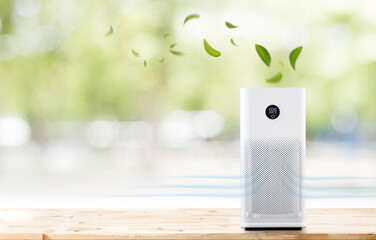Fototapeta air purifier a living room,  air cleaner removing fine dust in house. protect PM 2.5 dust and air pollution concept obraz