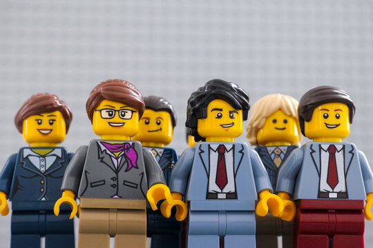 Tambov, Russian Federation - December 19, 2020 Lego businesspeople minifigures standing and looking into their successful future.