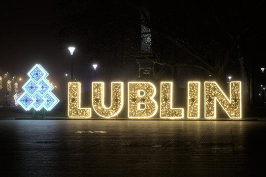 Illuminated inscription Lublin on Litewski Square in Lublin