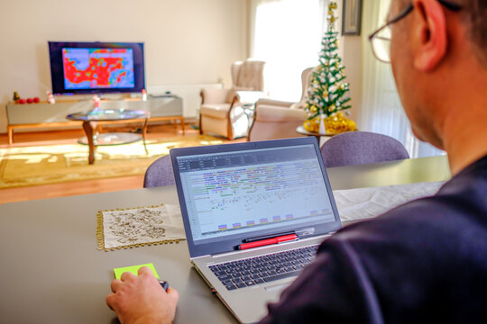 working at home with computer in living room at sunny day
