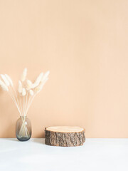 Natural wood podium and dry flowers in glass vase - fototapety na wymiar
