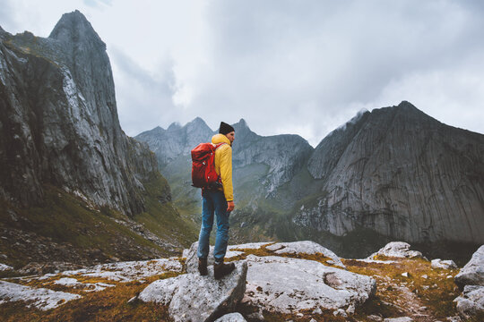 Man with backpack hiking solo in Norway mountains travel vacations outdoor adventure trekking active healthy lifestyle weekend getaway