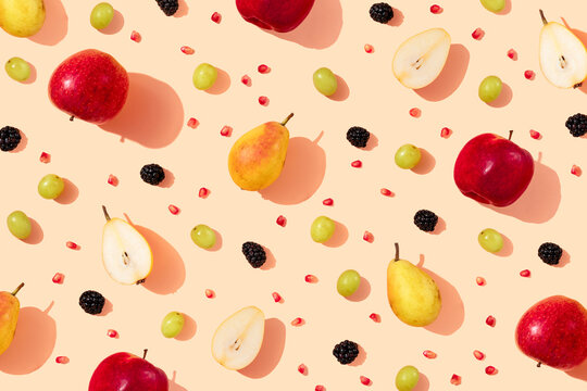 Pattern of fresh apples, pears, grapes, blackberries and pomegranate seeds