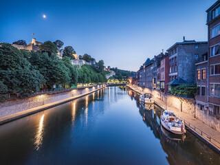 Belgium, Namur Province, Namur, Motorboats moored along city canal at dusk Fotobehang