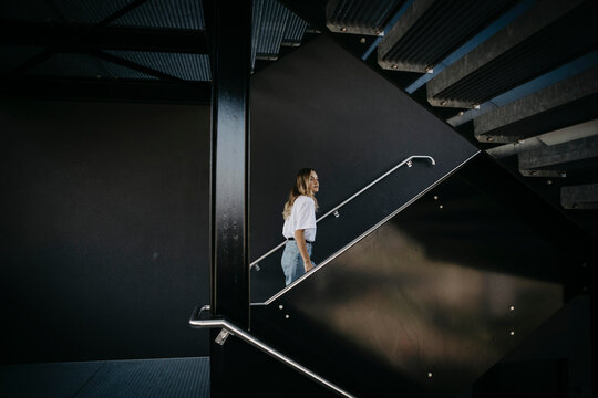 Young woman climbing on steps