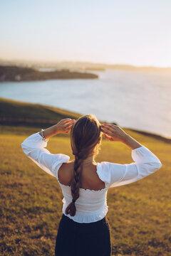 Young woman looking view at Mirador de La Providencia, Gijon, Spain