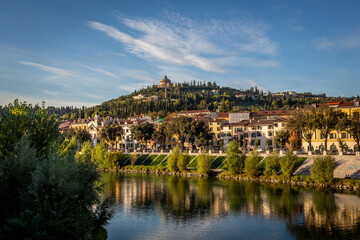 Italy, Veneto, Verona, City houses along Adige river in summer Fotobehang