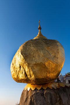 Myanmar, Mon state, Kyaiktiyo Pagoda, Golden rock against blue sky, low angle view