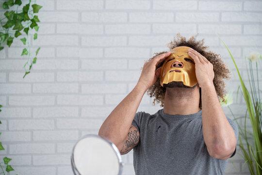 man applying face mask, Elgoibar, Spain