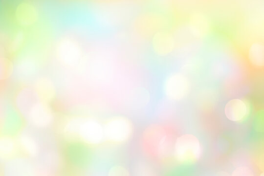 Soft colorful spring blurred background,glowing natural Easter holiday wallpaper.Abstract green blue yellow bokeh.