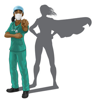Nurse or doctor super hero woman in surgical or hospital scrubs with stethoscope and mask PPE. Pointing at viewer in a we need or want you gesture. Revealed as a superhero by the shape of her shadow.