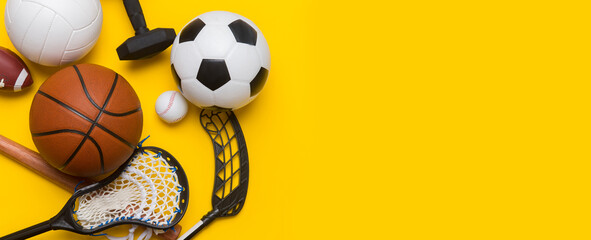 Assorted sports equipment including a soccer ball, volleyball, baseball, american football,...