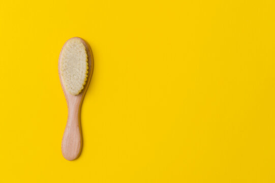 Natural soft goat bristle hair sweeping brush men beard on yellow background. Top view, space for your text