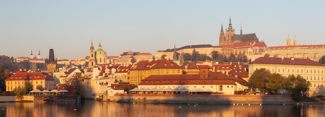 Prague - The Mala Strana, Castle and Cathedral from promenade over the Vltava river in the morning light.