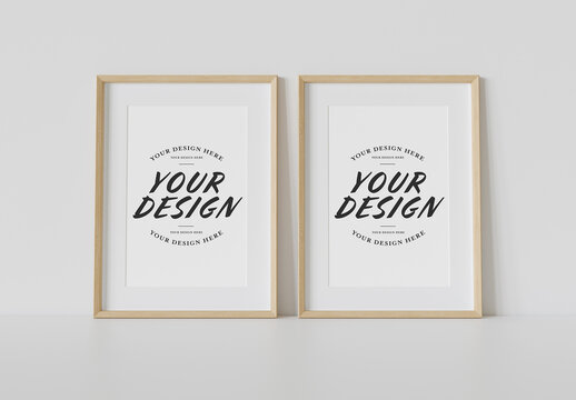 2 Wooden Frames Leaning on White Wall Mockup