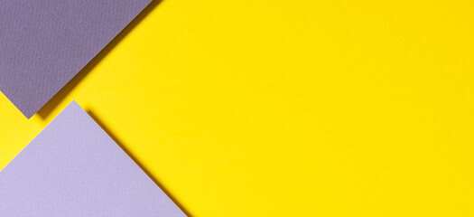 Abstract geometric paper banner background in yellow, light and dark gray colors