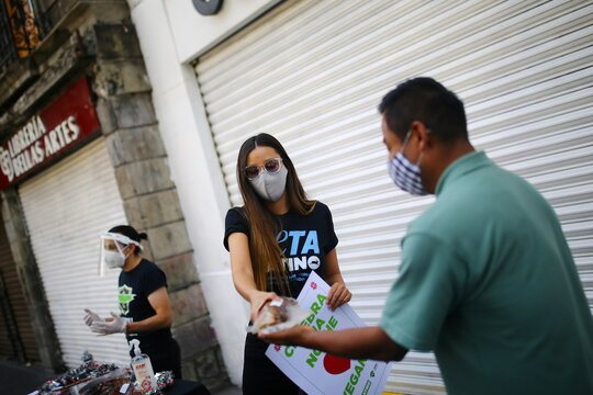 Mexican actress and activist Sofia Sisniega gives dinners to promote vegan meals during the Christmas celebrations in downtown Mexico City