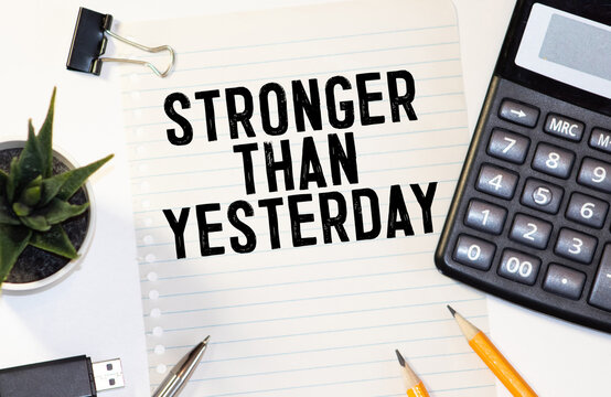 stronger than yesterday white chalk text on a vintage slate blackboard.