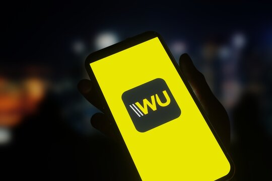 Logo of financial services company Western Union displayed on smartphone screen. Editorial 3d rendering.