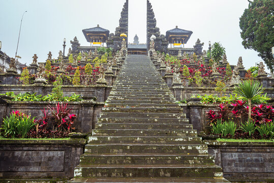Steps to the gate in Besakih temple on Bali island in Indonesia on a rainy day