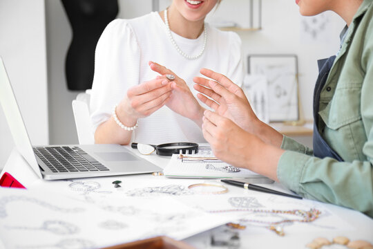 Female jewelry designers with adornment in office