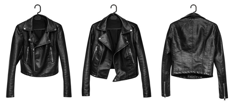 Woman leather jacket design concept on hanger holding in hand front view isolated on white background