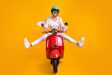 Full length photo of shocked crazy girl biker ride motor bike impressed fast speed adventure wear teal helmet glasses striped shirt pants trousers isolated bright shine color background