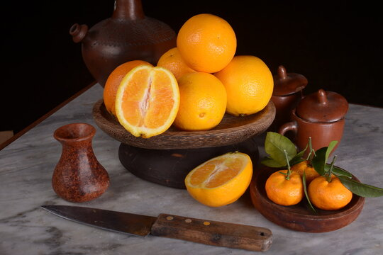 Fresh sunkist citrus fruit on a dark background