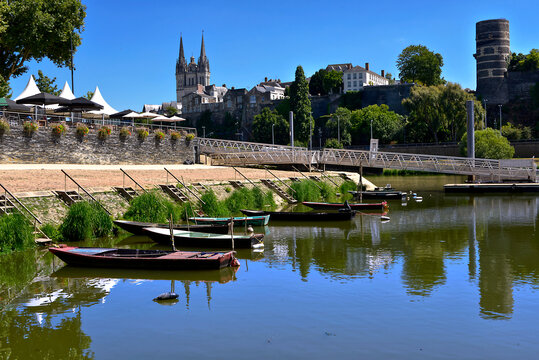 Little boats on the Maine river at Angers and the cathedral Saint Maurice in the background. Angers is a commune in the Maine-et-Loire department, Pays de la Loire region, in western France