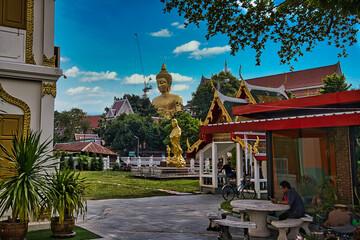 Golden buddha statue in Bangkok Thailand located along the river  Fotobehang