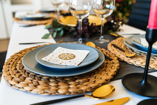 Festive table setting with glowing garlands before Christmas celebration party