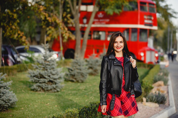 young woman near english bus. London red bus - girl enjoying life. Beautiful smiling female in London, England, United Kingdom. Woman jogging training in city with red double decker bus